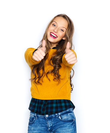 sweater girl: people, gesture, style and fashion concept - happy young woman or teen girl in casual clothes showing thumbs up