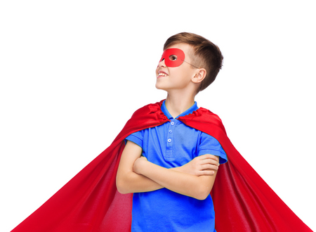 preteen boys: carnival, childhood, power, gesture and people concept - happy boy in red super hero cape and mask