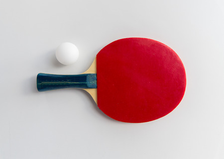 sport, fitness, healthy lifestyle and objects concept - close up of ping-pong or table tennis rackets with ball Stock Photo