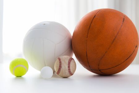 baseball stuff: sport, fitness, game and objects concept - close up of different sports balls set