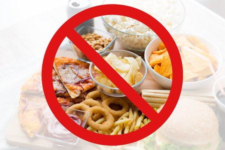 no food: fast food, low carb diet, fattening and unhealthy eating concept -close up of fast food snacks and cola drink behind no symbol or circle-backslash prohibition sign Stock Photo