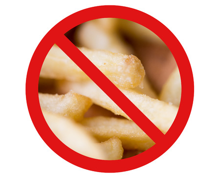 fattening: fast food, low carb diet, fattening and unhealthy eating concept - close up of french fries behind no symbol or circle-backslash prohibition sign