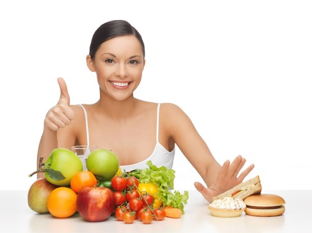lose weight: picture of woman with fruits showing thumbs up