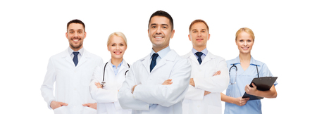 medicine, profession, teamwork and healthcare concept - international group of smiling medics or doctors with clipboard and stethoscopes. Stock Photo