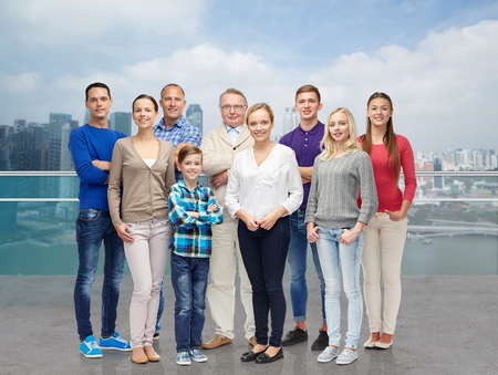 latin family: family, travel, tourism, generation and people concept - group of smiling men and women over singapore city background Stock Photo