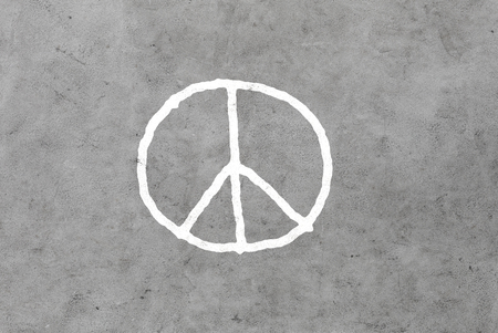 pacifism: symbolic, pacifism and hippie concept - peace sign drawing on gray concrete wall