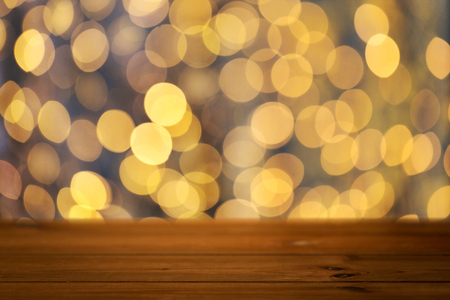 table surface: holidays, new year and celebration concept - close up of empty wooden surface or table over christmas golden lights background