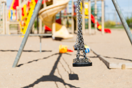teeter: childhood, equipment and object concept - close up of swing on playground outdoors at summer