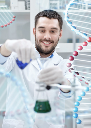 scientist man: science, chemistry, technology, biology and people concept - young scientist mixing reagents from glass flasks and making test or research in clinical laboratory over dna molecule structure Stock Photo