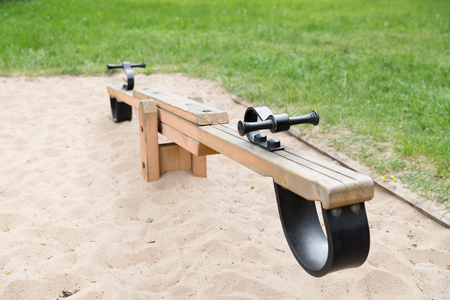 teeter: childhood, equipment and object concept - close up of swing or teeterboard on playground outdoors Stock Photo