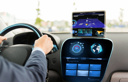 drive car: transport, destination, modern technology and people concept - close up of man driving car with navigation system on tablet pc computer