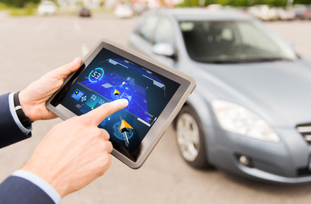 car navigation: transport, business trip, navigation, technology and people concept - close up of male hands with navigator tablet pc computer and car outdoors