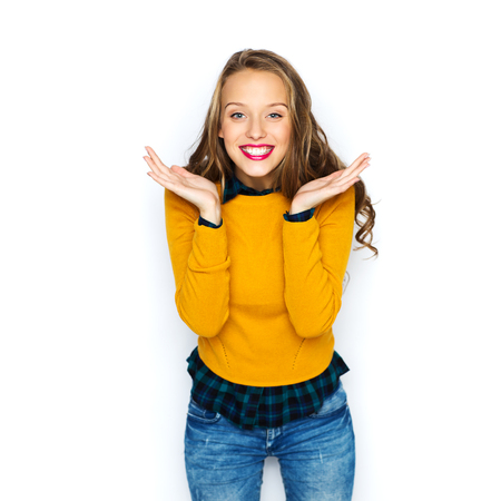 people, style and fashion concept - happy young woman or teen girl in casual clothes having fun Stock Photo