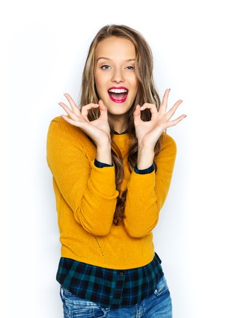 a ok: people, gesture, style and fashion concept - happy young woman or teen girl in casual clothes showing ok hand sign