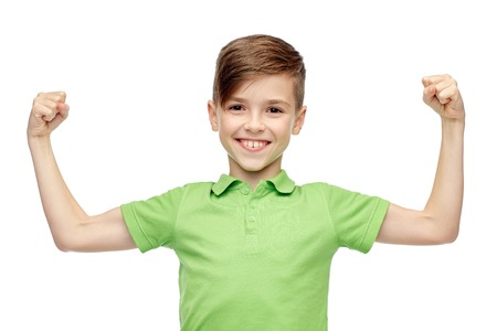 ten empty: childhood, power, strength and people concept - happy smiling boy in green polo t-shirt showing strong fists