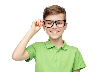 pre teen boy: childhood, vision, school, education and people concept - happy smiling boy in green polo t-shirt in eyeglasses