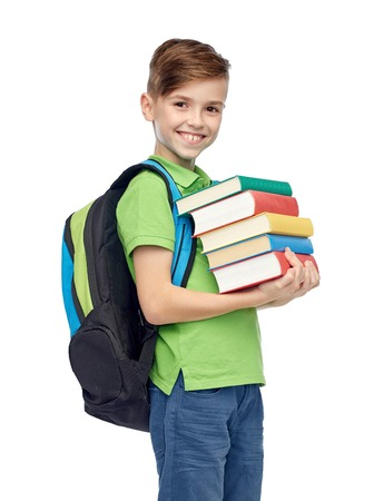 childhood, school, education and people concept - happy smiling student boy with school bag and books