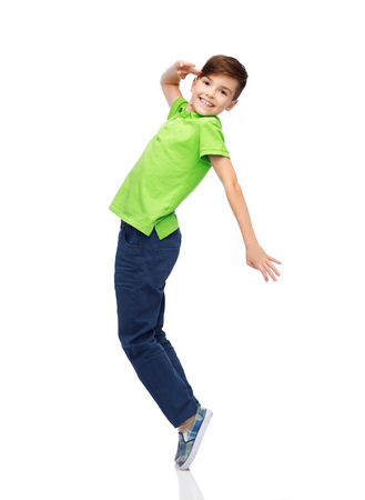 bewegung menschen: happiness, childhood, freedom, movement and people concept - smiling boy having fun or dancing