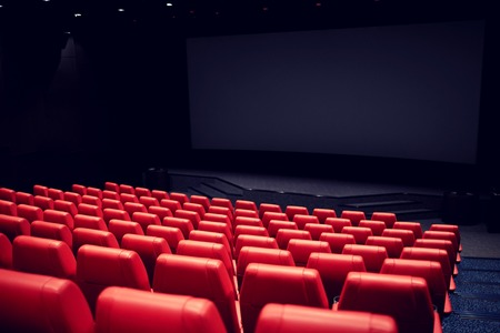 entertainment and leisure concept - movie theater or cinema empty auditorium with red seats Stok Fotoğraf