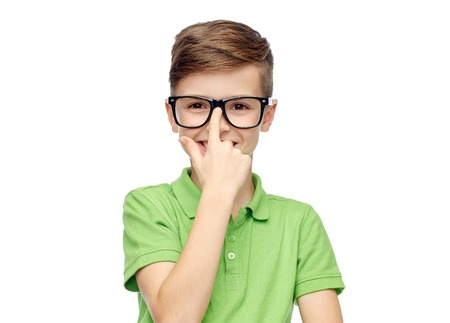 pre teen boys: childhood, vision, school, education and people concept - happy smiling boy in green polo t-shirt in eyeglasses