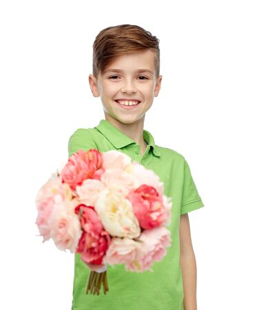 pre teen boy: childhood, holidays and people concept - happy boy holding flower bunch Stock Photo