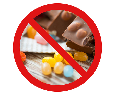 fattening: low carb diet, fattening and unhealthy eating concept - close up of jelly beans candies and chocolate behind no symbol or circle-backslash prohibition sign