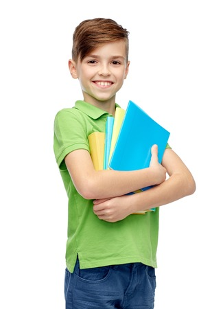 childhood, school, education and people concept - happy smiling student boy with folders and notebooks Stok Fotoğraf