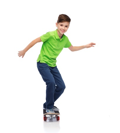 pre teens: childhood, leisure, school and people concept - happy smiling boy with skateboard Stock Photo