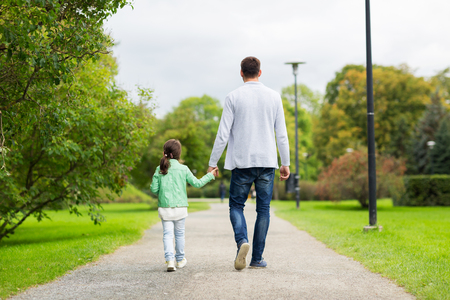 father daughter: family, parenthood, fatherhood, adoption and people concept - happy father and little girl walking in summer park