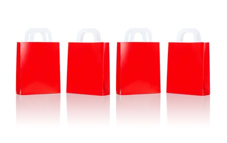 consumerism: sale, consumerism, advertisement and retail concept - many blank red shopping bags
