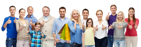 gesture, sale, shopping and people concept - group of smiling men, women and kids showing thumbs up and holding shopping bags