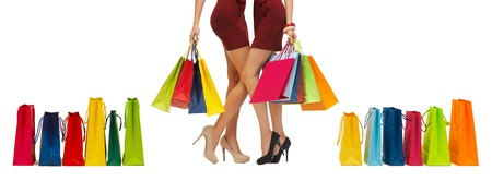 high  heeled: people, sale and discount concept - close up of women in red short skirts and high heeled shoes with shopping bags