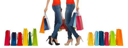 people, sale and consumerism concept - close up of women with shopping bags photo