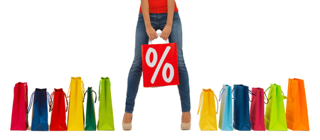 people, sale and discount concept - close up of woman with percentage sign on red shopping bag photo