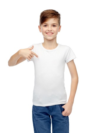 ten empty: childhood, fashion, advertisement and people concept - happy boy in white t-shirt and jeans pointing finger to himself Stock Photo