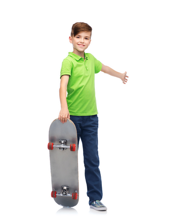 pre teen boy: childhood, leisure, school and people concept - happy smiling boy with skateboard Stock Photo
