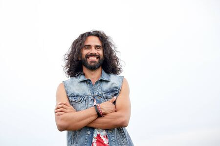 gipsy: subculture, youth culture and people concept - smiling young hippie man in demin vest Stock Photo