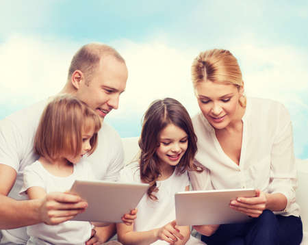 beautiful preteen girl: family, technology and people - smiling mother, father and little girls with tablet pc computers over blue sky background