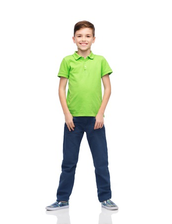 pre adolescent boy: childhood, fashion and people concept - happy smiling boy in green polo t-shirt