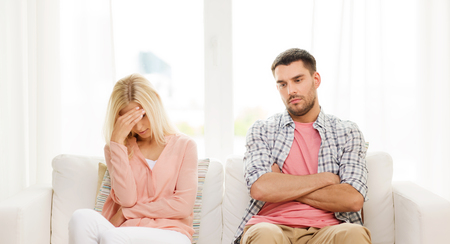 angry couple: people, relationship difficulties, conflict and family concept - unhappy couple having argument at home Stock Photo