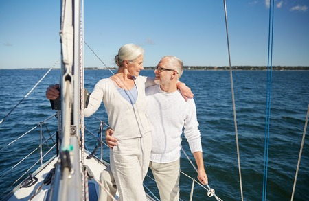 sailing, age, tourism, travel and people concept - happy senior couple hugging on sail boat or yacht deck floating in sea Stok Fotoğraf - 51581864