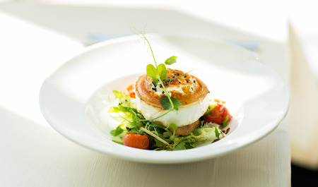 cuisine: food, culinary, haute cuisine and cooking concept - close up of halloumi cheese salad with vegetables on plate at restaurant