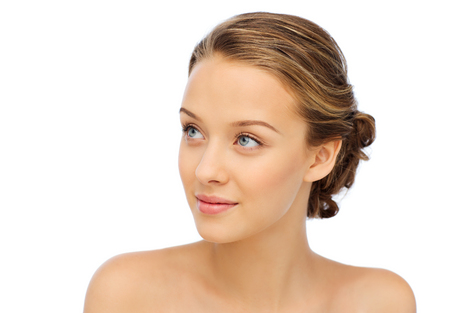 smiling face: smiling young woman face and shoulders Stock Photo