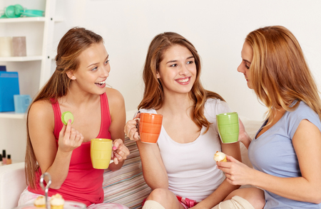 hearsay: happy friends or teenage girls drinking tea and eating sweets at home