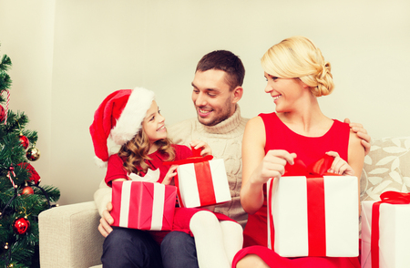 opening gift: happy family opening gift boxes