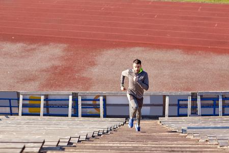 upstairs: man running upstairs on stadium Stock Photo