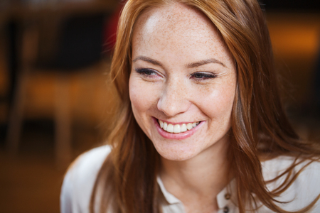 smiling happy young redhead woman face Stock Photo