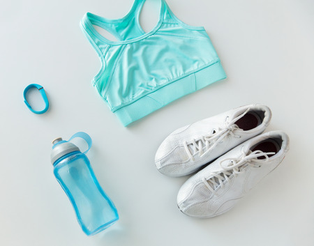 sport fitness: close up of female sports clothing, heart-rate watch and bottle set Stock Photo