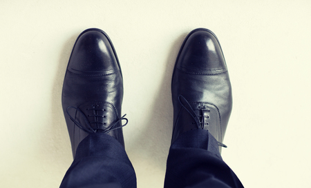 leather boots: close up of man legs in elegant shoes with laces or lace boots