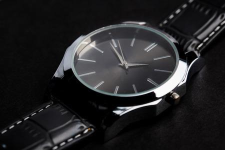 wristlet: close up of black classic male wristwatch